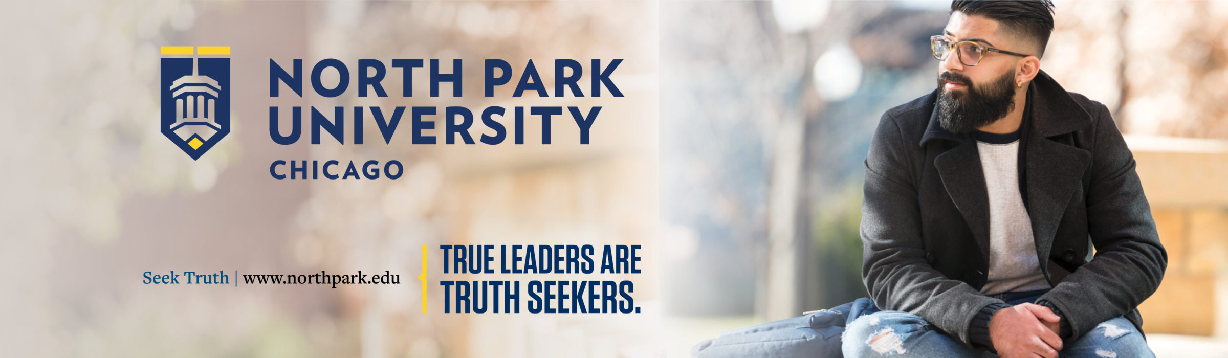"""""""True Leaders Are Truth Seekers."""" billboard ad with male student."""